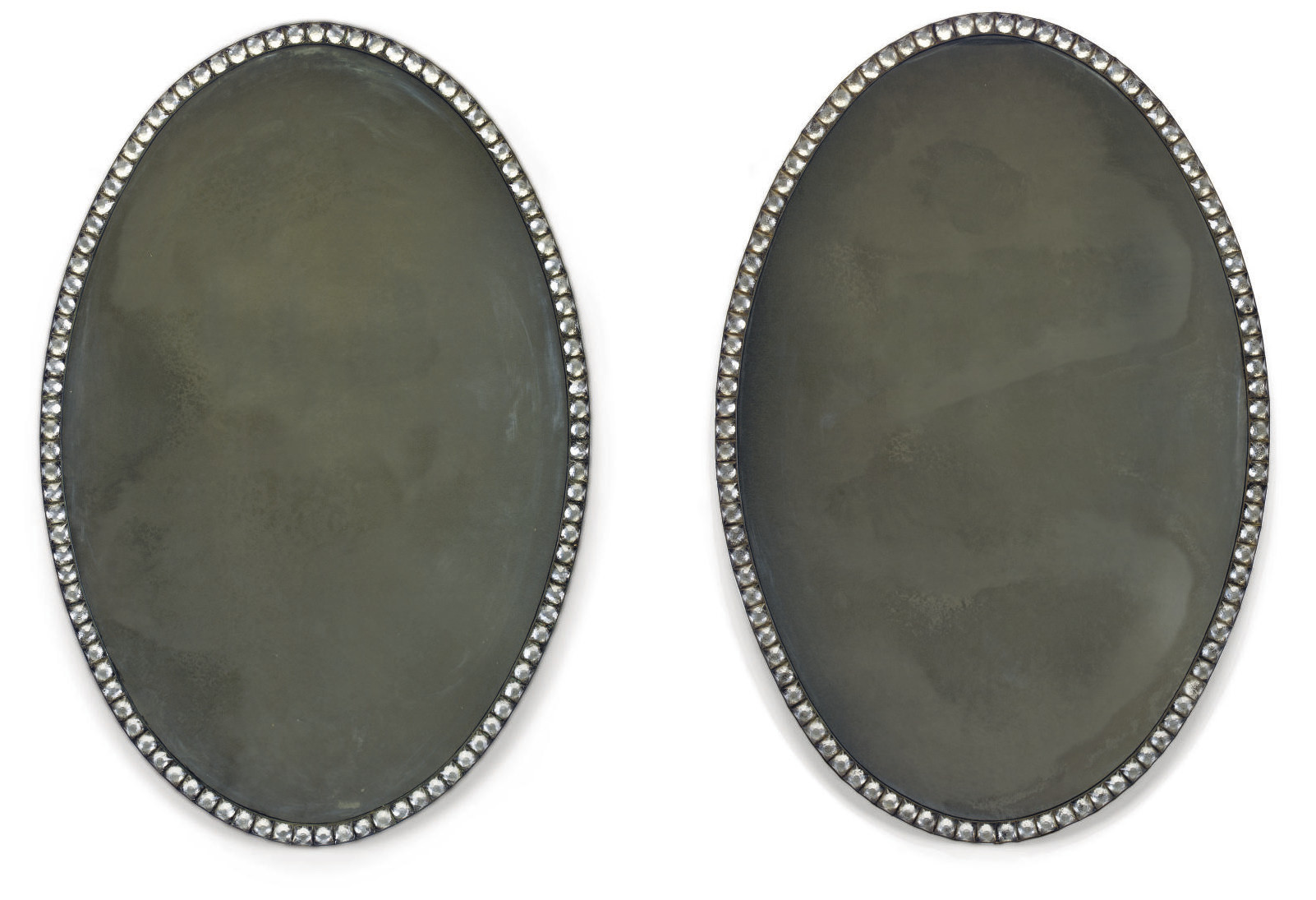 A PAIR OF IRISH CUT-GLASS OVAL MIRRORS