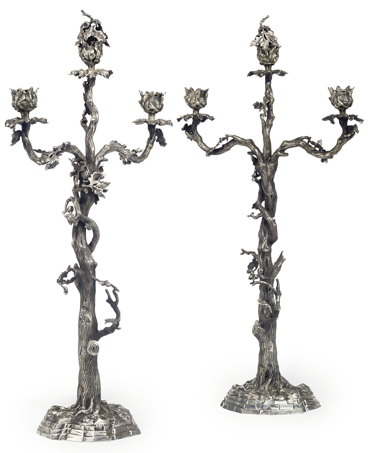 A PAIR OF VICTORIAN SILVER-PLATED THREE-LIGHT CANDELABRA