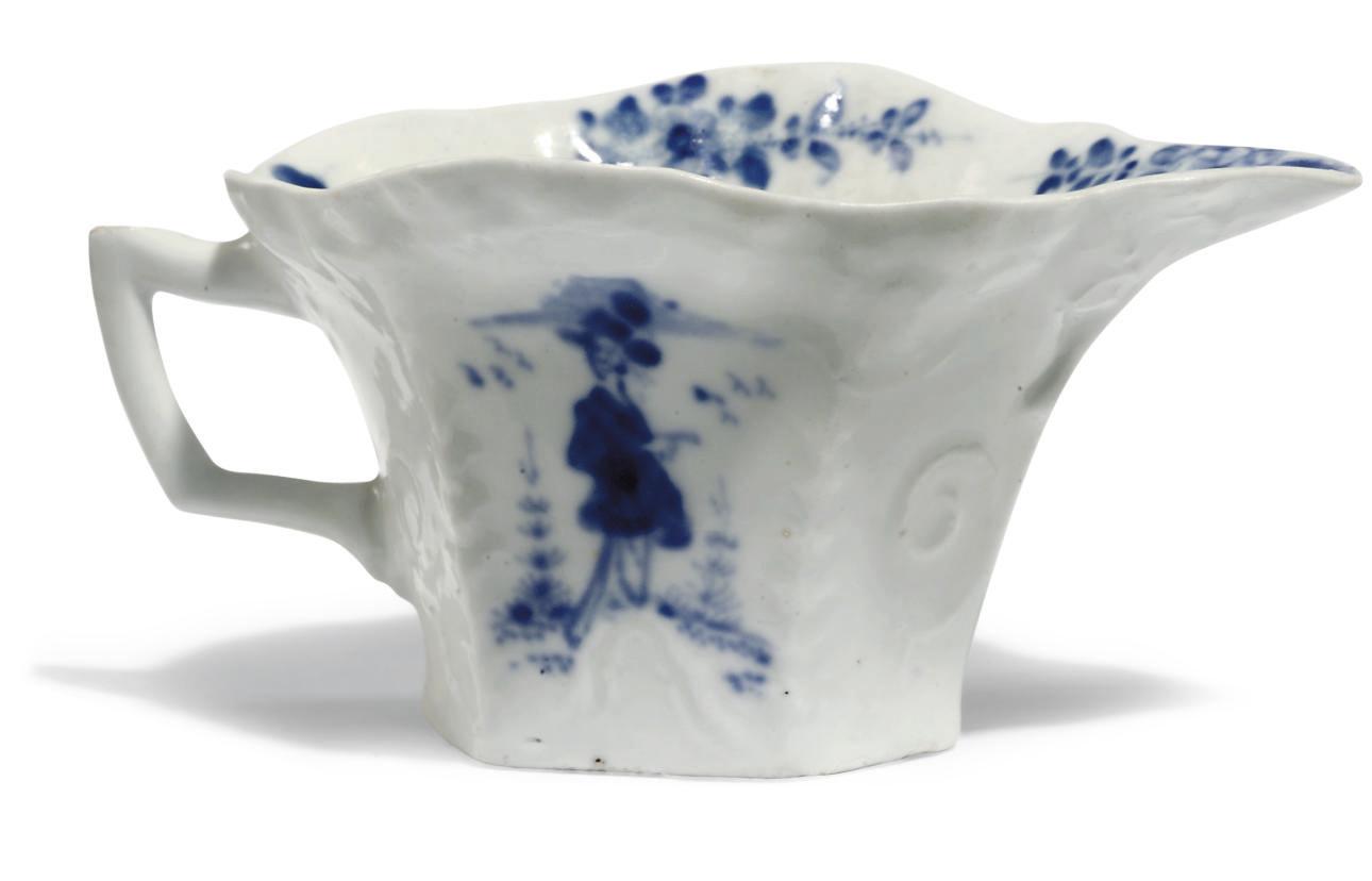A LUND'S BRISTOL BLUE AND WHITE FLARED HEXAGONAL CREAM-BOAT