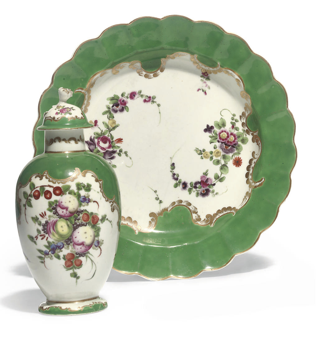 A WORCESTER GREEN-GROUND PLATE AND A LATER-DECORATED TEA-CADDY AND COVER