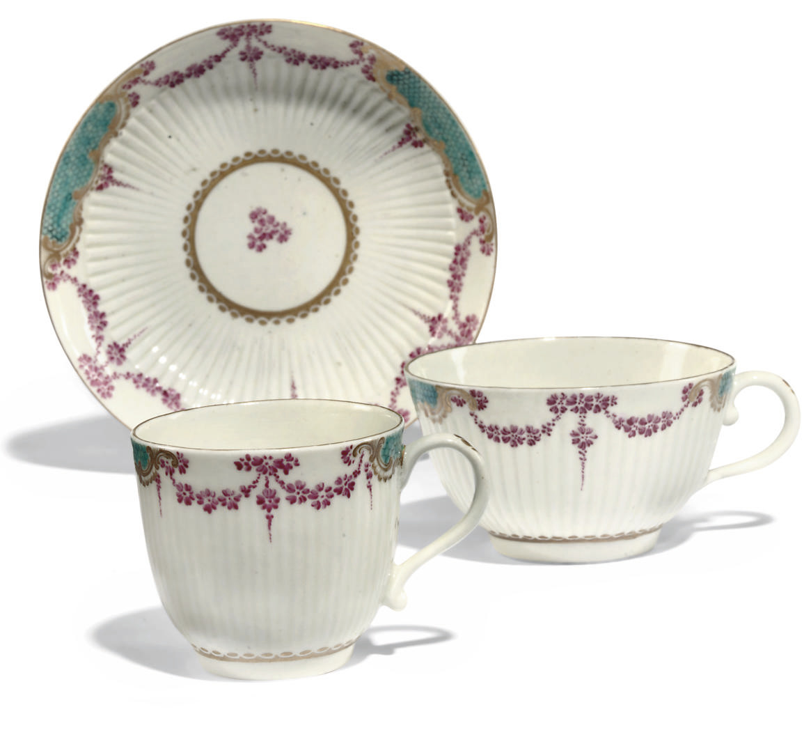 A WORCESTER REEDED TEACUP, COFFEE-CUP AND SAUCER