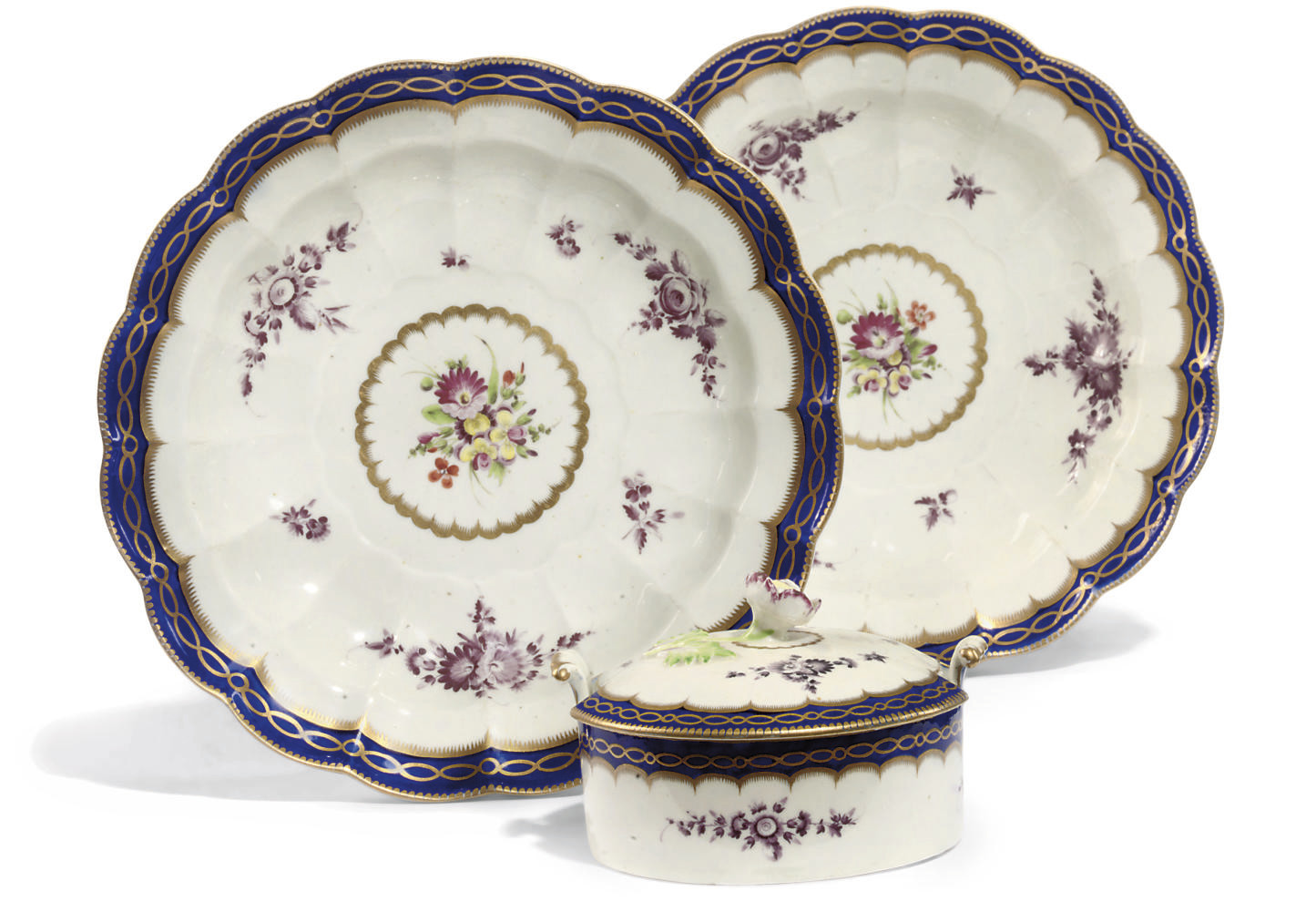 A WORCESTER TWO-HANDLED CYLINDRICAL BUTTER-TUB AND COVER AND TWO FLUTED DISHES
