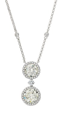 A DIAMOND TWO-STONE PENDANT, B