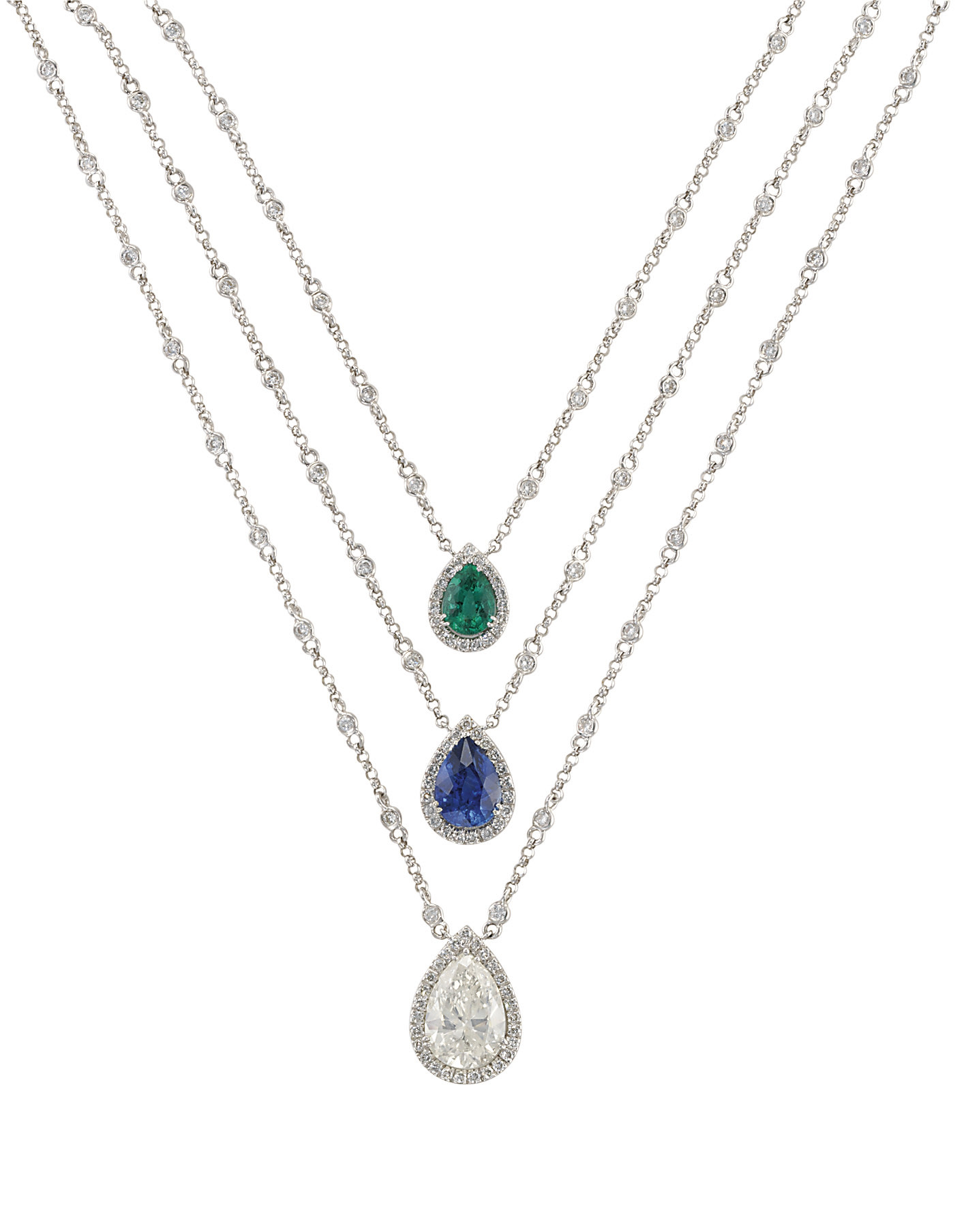 A DIAMOND, SAPPHIRE AND EMERAL