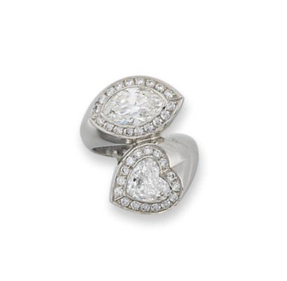 A DIAMOND TWO-STONE RING, BY H