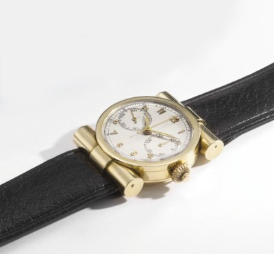 Swiss. A lady's unusual 18K go