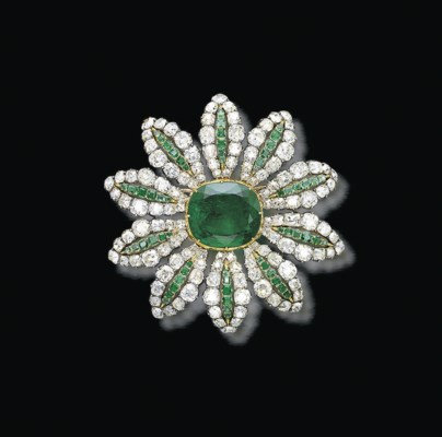 A DELICATE ANTIQUE EMERALD AND