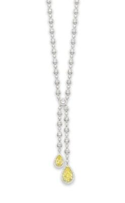 AN ELEGANT COLOURED DIAMOND AN