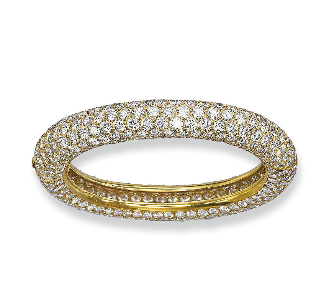 A DIAMOND BANGLE, BY CARTIER