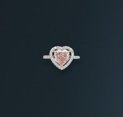 A DELICATE COLOURED DIAMOND AN
