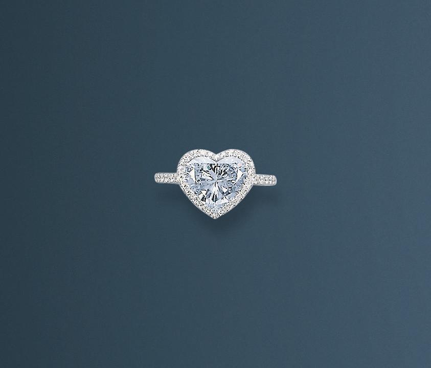A CHARMING COLOURED DIAMOND AN