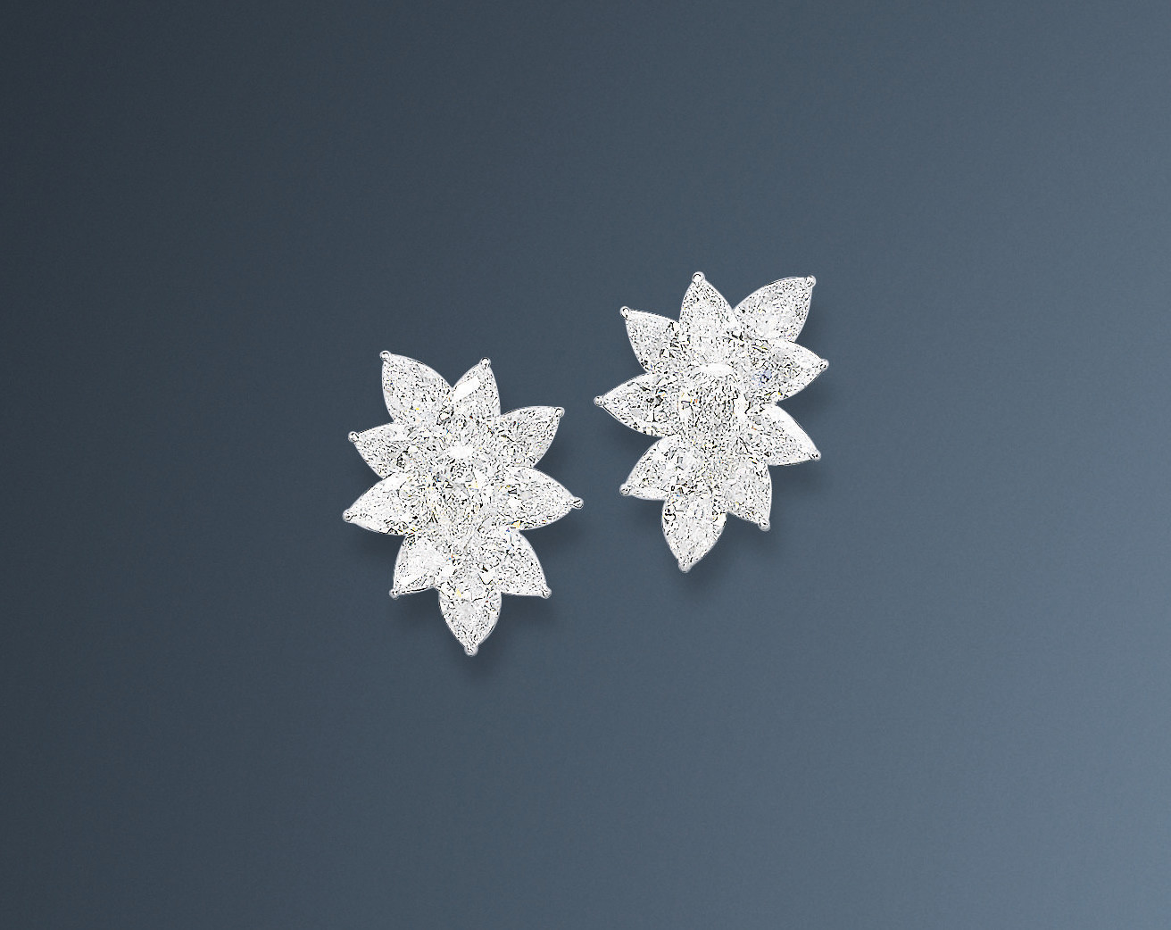 A PAIR OF FINE DIAMOND EAR CLIPS, BY WILLIAM GOLDBERG