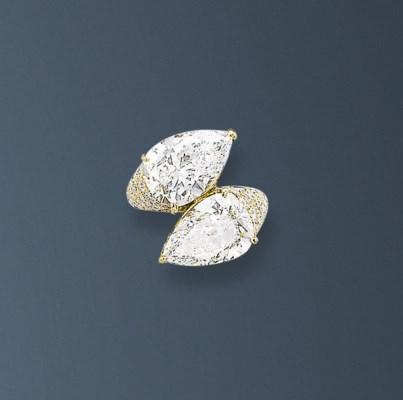 A DIAMOND 'TOI & MOI' RING, BY