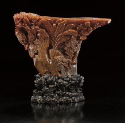 A FINELY CARVED RHINOCEROS HOR