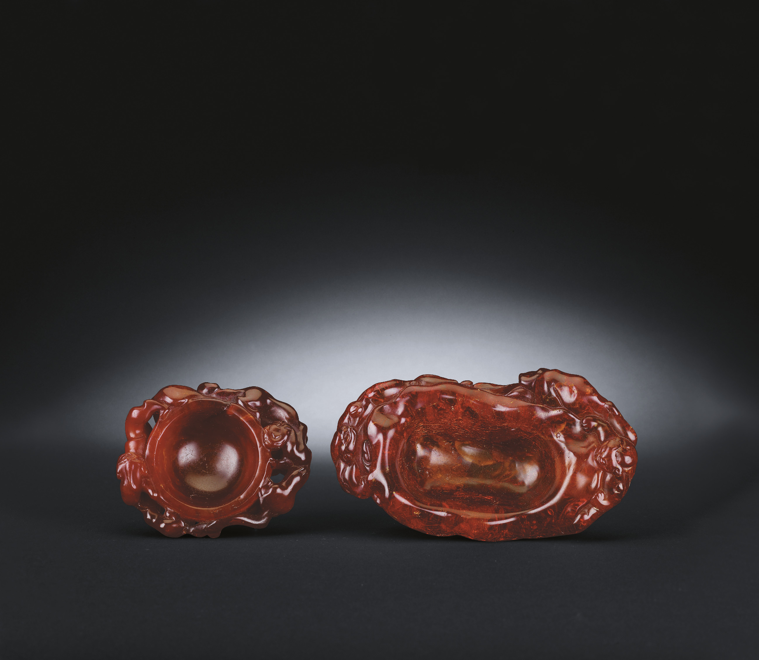 TWO UNUSUAL CARVED AMBER WATER