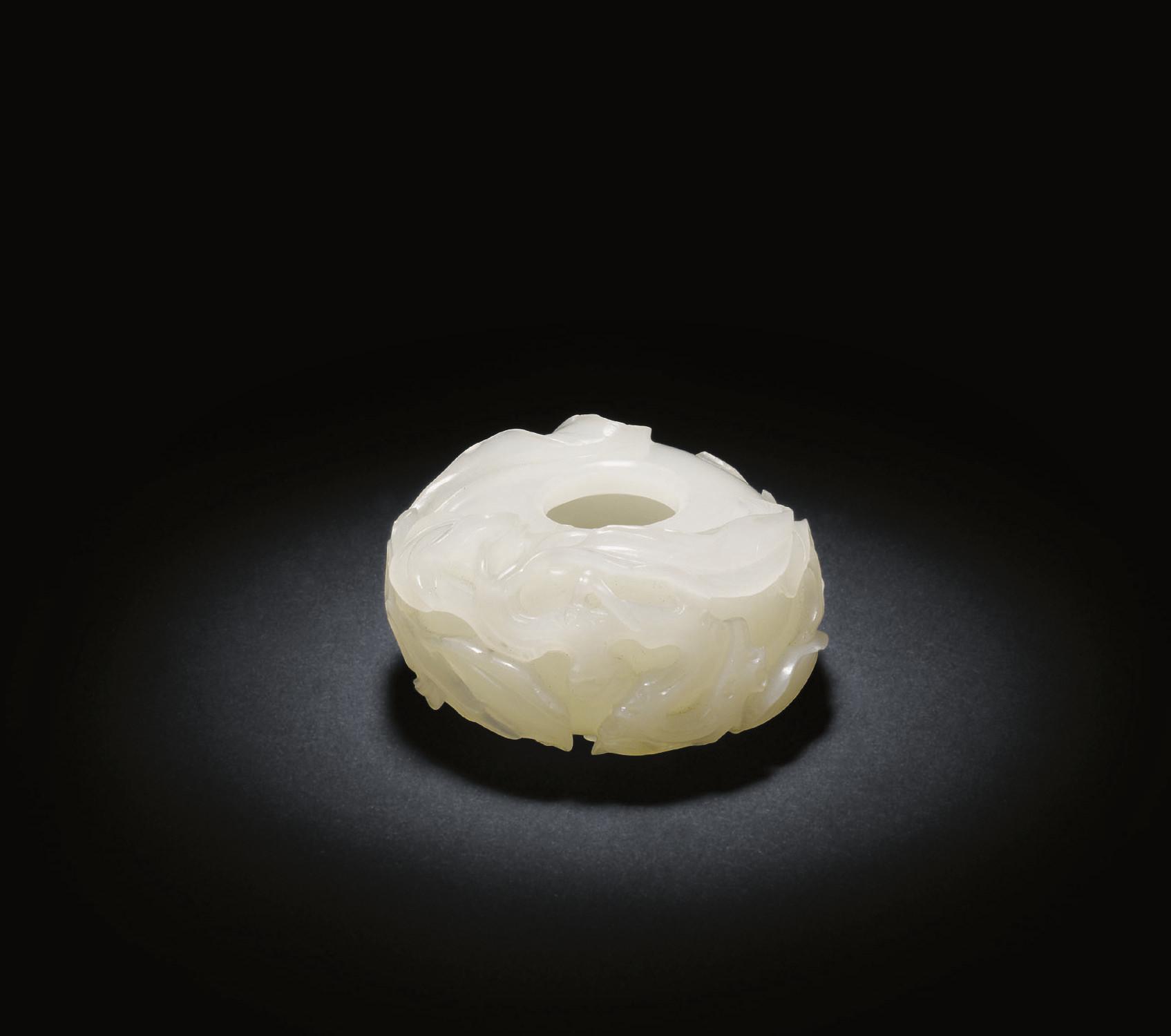 A SMALL WHITE JADE PEACH-SHAPE