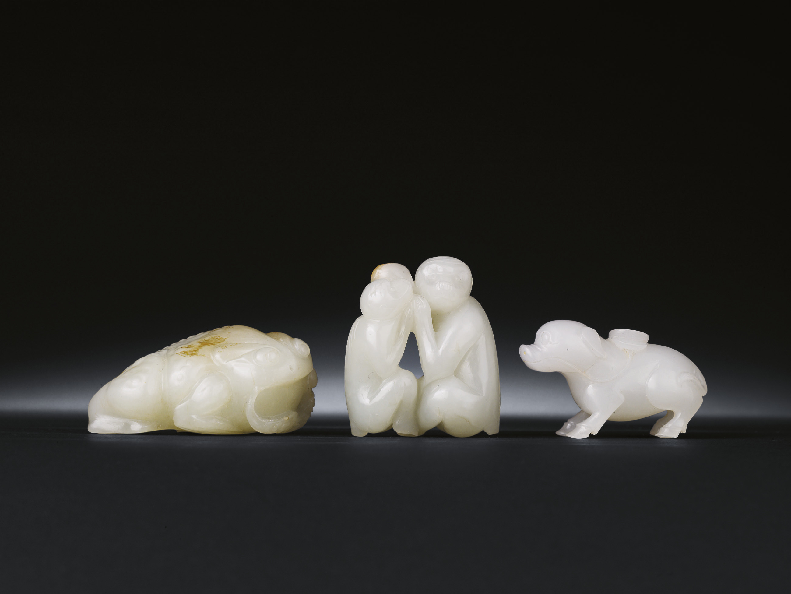 THREE WHITE JADE CARVINGS OF A