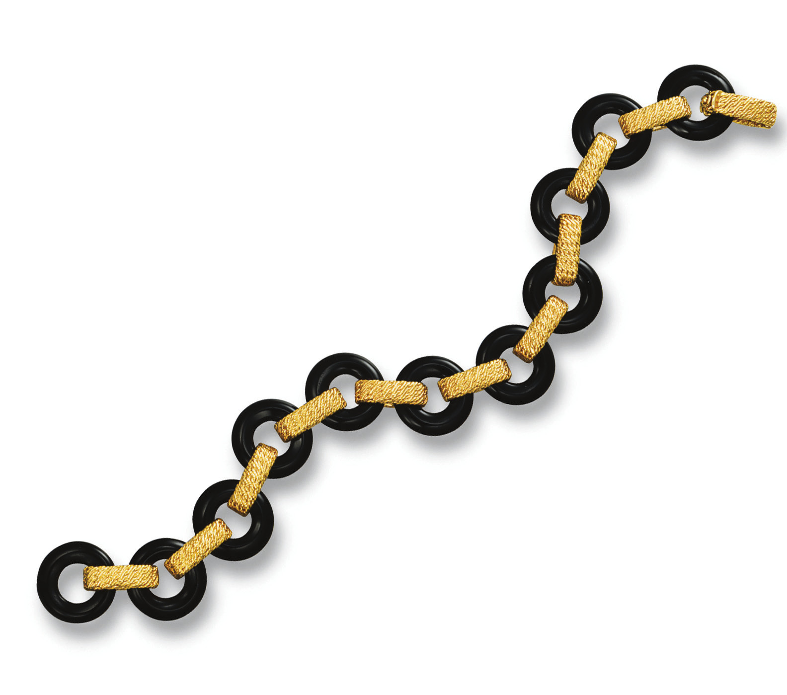 AN ONYX AND GOLD BRACELET, BY