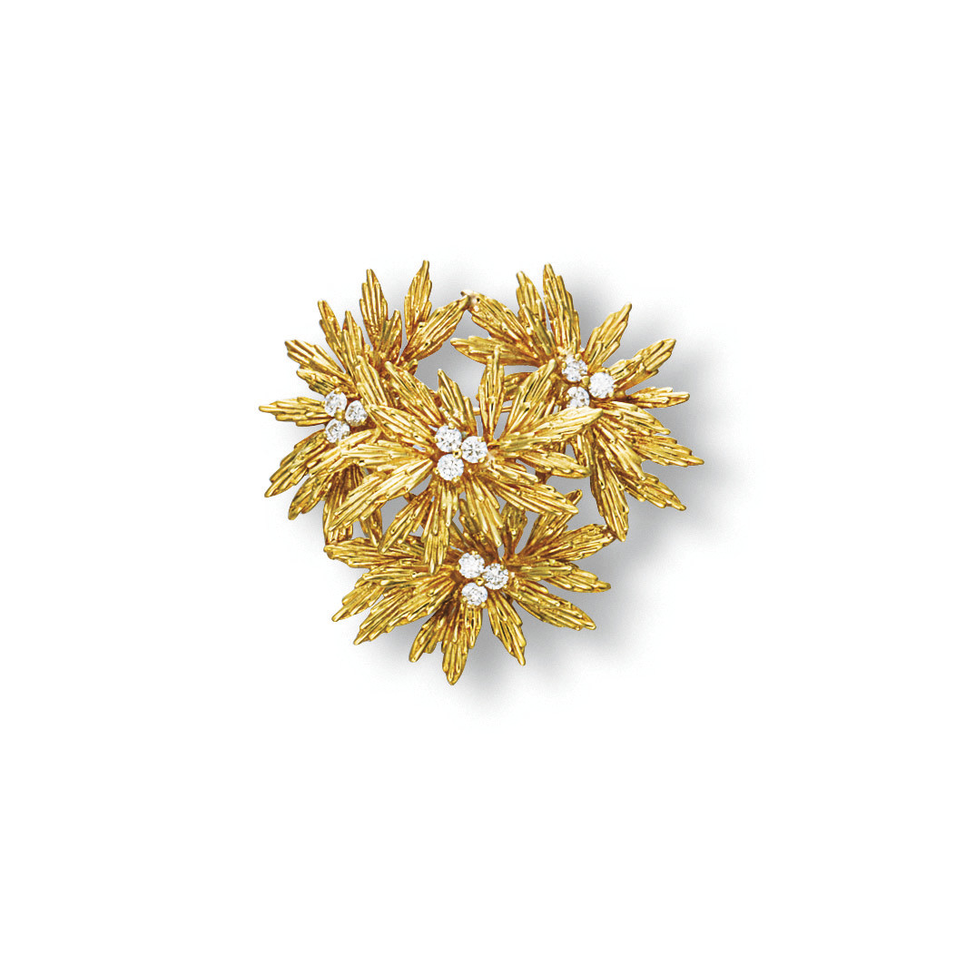 A GOLD AND DIAMOND BROOCH, BY