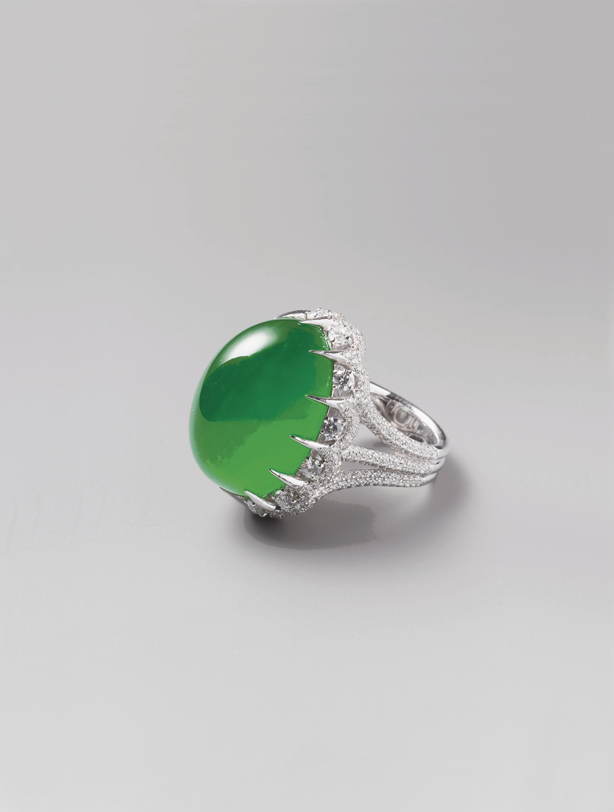A JADEITE RING AND DIAMOND RIN