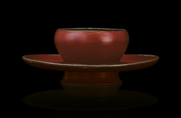 A RARE RED LACQUER BOWLSTAND,