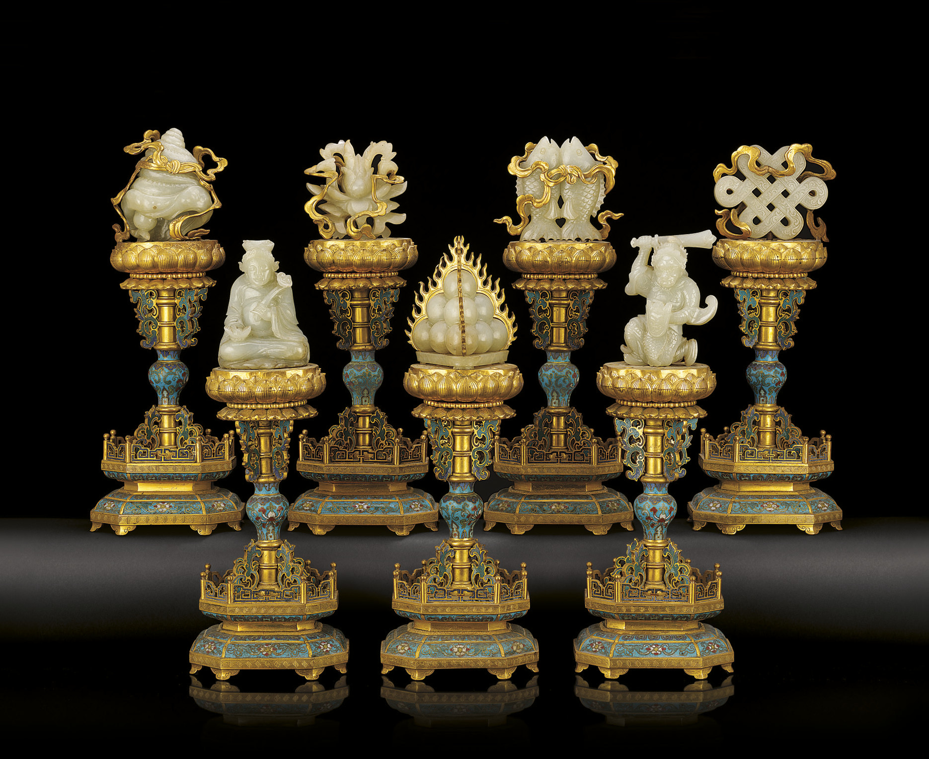 AN EXTREMELY RARE GROUP OF SEVEN IMPERIAL CLOISONNE ENAMEL, GILT BRONZE AND WHITE JADE ALTAR EMBLEMS