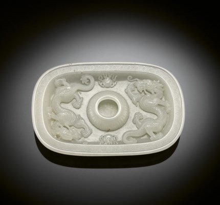 A FINELY CARVED WHITE JADE 'DR