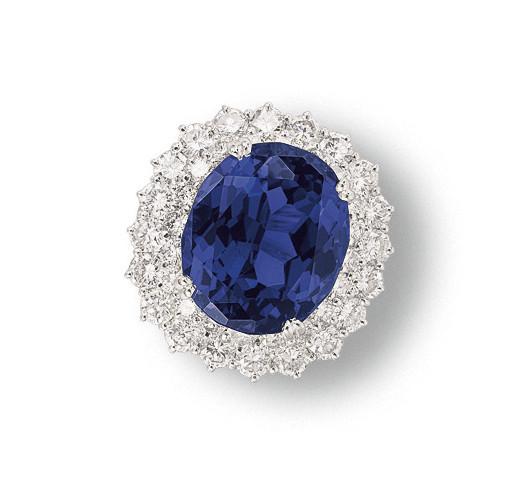 A TANZANITE AND DIAMOND RING