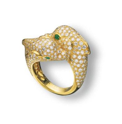 A DIAMOND AND EMERALD 'DOLPHIN