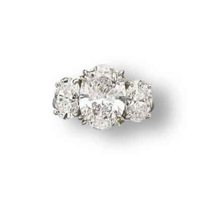 A DIAMOND THREE-STONE RING, BY