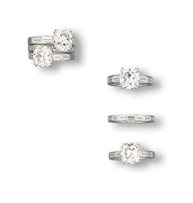A SET OF DIAMOND RINGS, BY SUW
