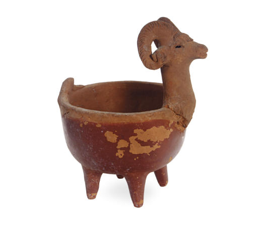 A POTTERY RAM FORM BOWL ON FOU