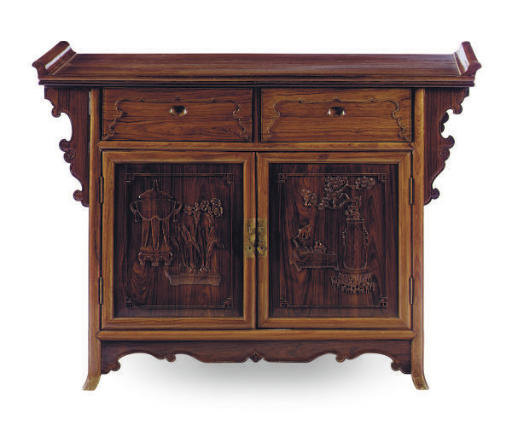 A CHINESE CARVED HARDWOOD CABI