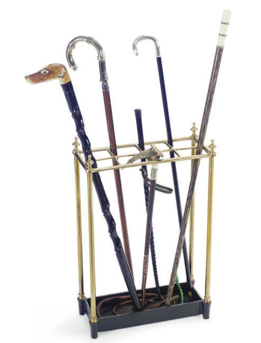 A BRASS AND CAST IRON STAND TO