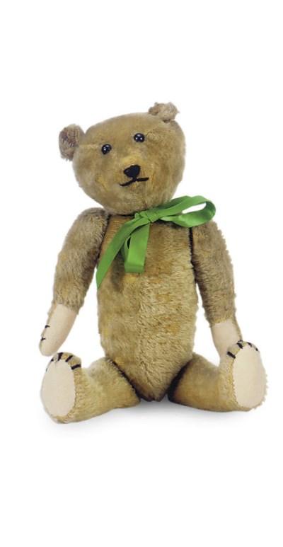 A BROWN MOHAIR TEDDY BEAR,