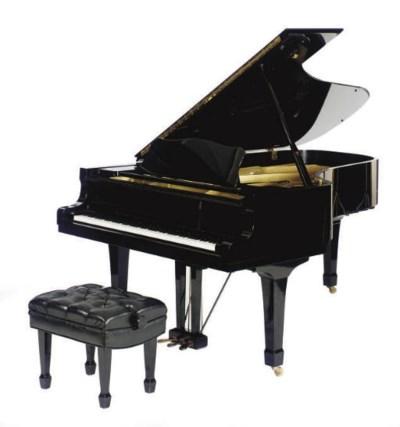 A YAMAHA EBONIZED GRAND PIANO,