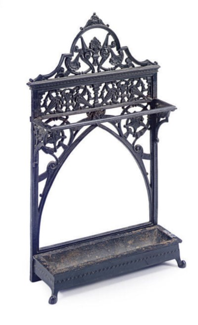 AN IRON UMBRELLA STAND AND DRI