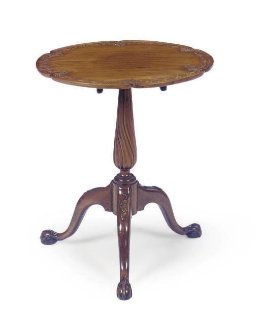 A COLONIAL PADOUK TRIPOD TABLE