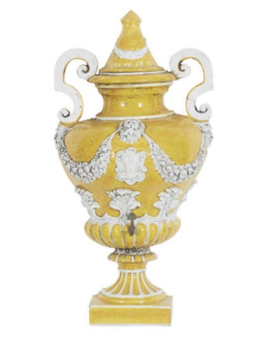 A TERRACOTTA YELLOW AND WHITE-