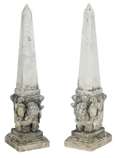 A PAIR OF STONE OBELISKS ON EL