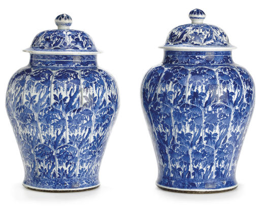 A VERY LARGE PAIR OF BLUE AND WHITE JARS AND COVERS