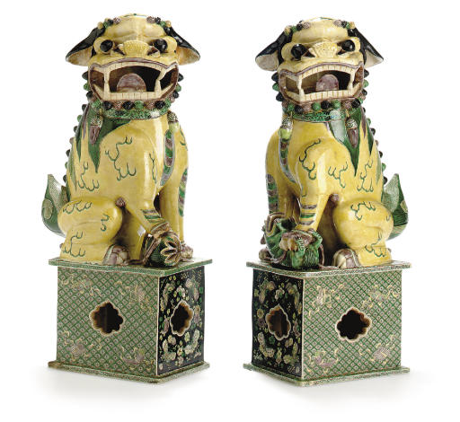 A VERY LARGE PAIR OF BISCUIT-GLAZED BUDDHIST LIONS
