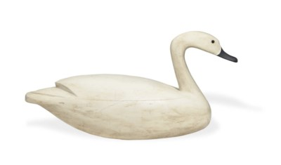 A HOLLOW CARVED SWAN