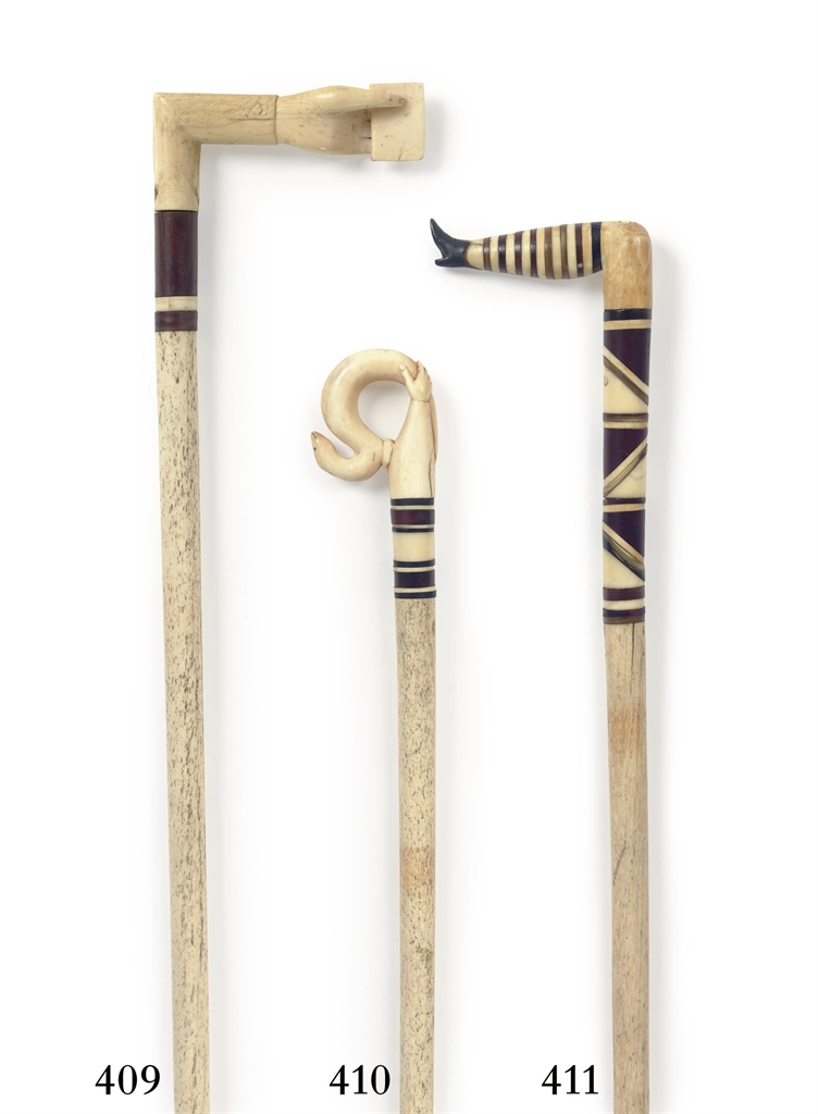 AN IVORY AND HORN 'NAUGHTY STO