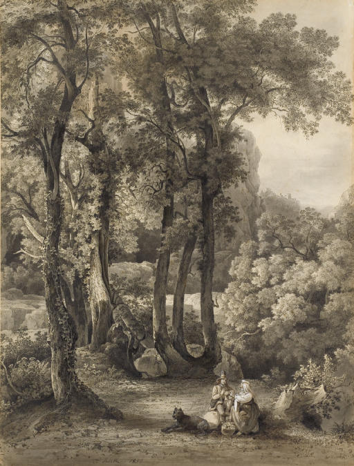 A seated couple and their dog in a glade