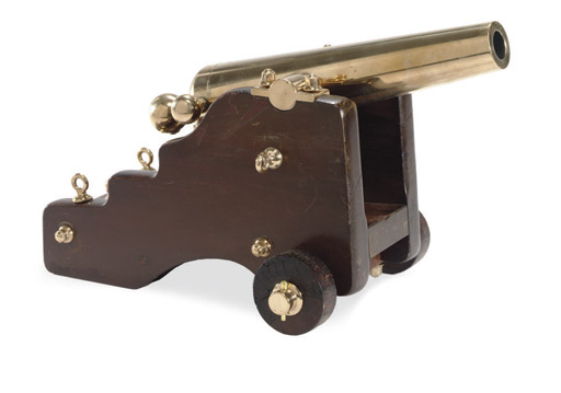 A small brass signal cannon