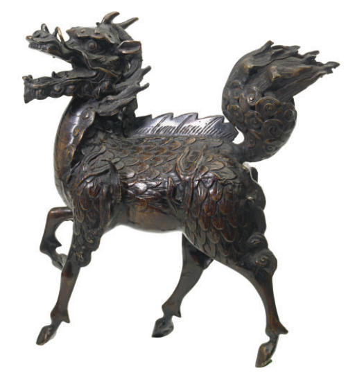 A CHINESE BRONZE FIGURE OF A K