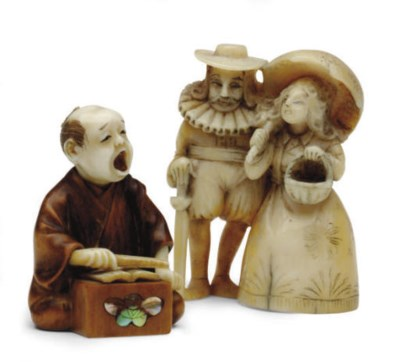 AN IVORY AND A WOOD JAPANESE N