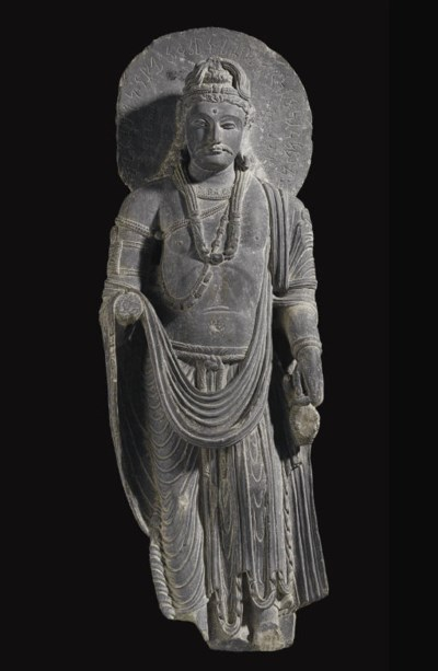 An important gray schist figur