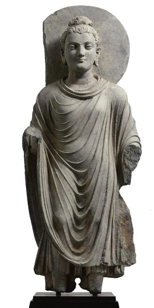 A gray schist figure of Buddha